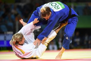 Portugal′s Telma Monteiro (white) competes with Romania′s Corina Caprioriu during their women′s -57kg judo contest bronze medal A match of the Rio 2016 Olympic Games in Rio de Janeiro on August 8, 2016. / AFP PHOTO / Toshifumi KITAMURATOSHIFUMI KITAMURA/AFP/Getty Images ** OUTS - ELSENT, FPG, CM - OUTS * NM, PH, VA if sourced by CT, LA or MoD **